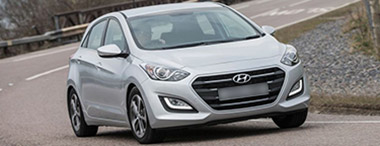 gray i30 Hyundai in motion